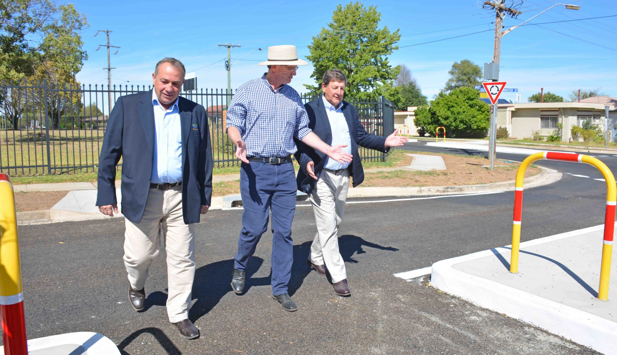 Sam Romano Andrew Gee Reg Kidd inspect new Canobolas High roundabout