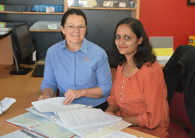 New volunteer Preeti Singla is pictured with Migrant Support, Worker Monica Engel