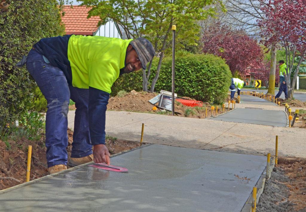 Alo Finan smooths concrete on a new path