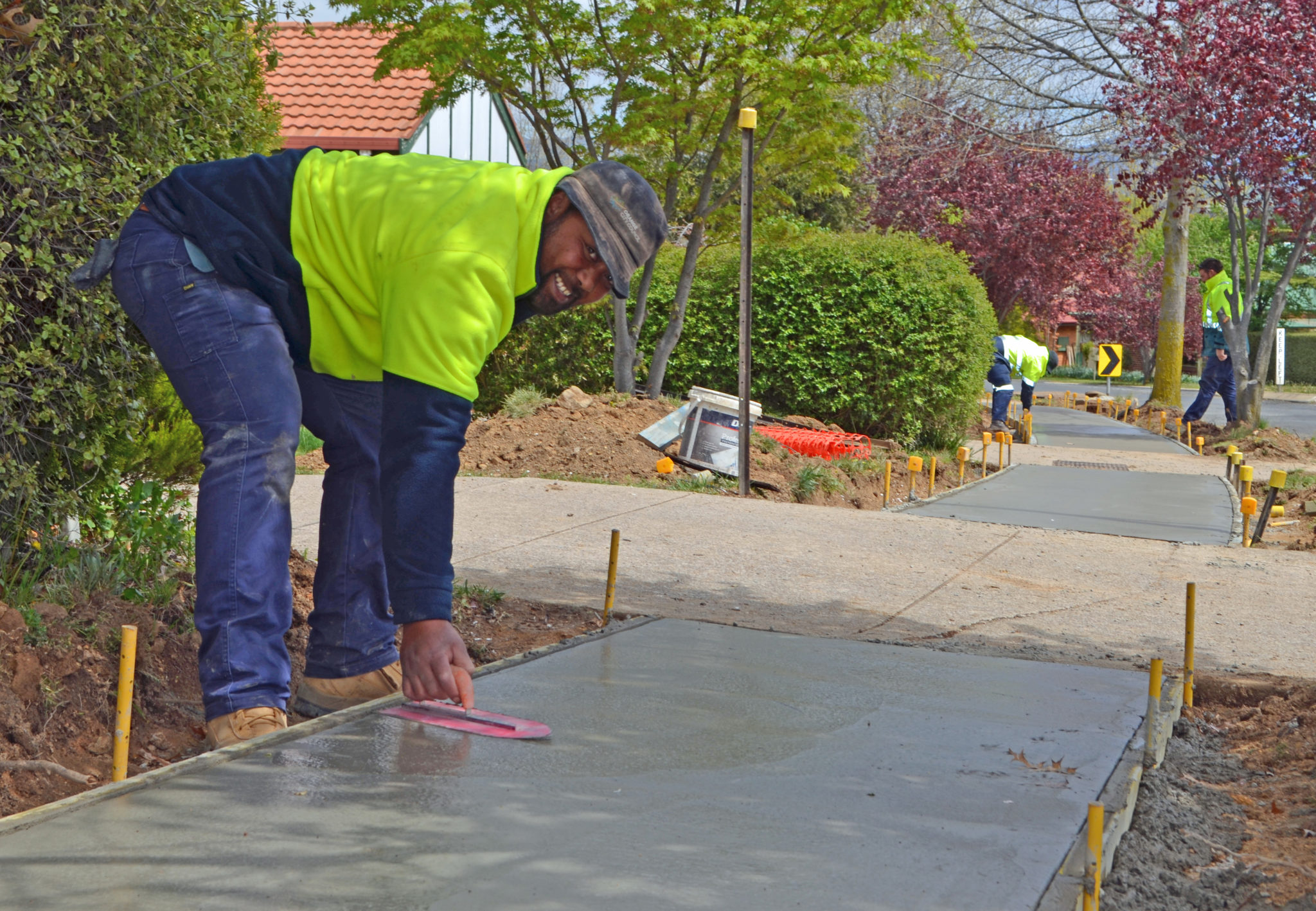 PATHWAY : Council concreting crew member Alo Finan smooths concrete on a new path