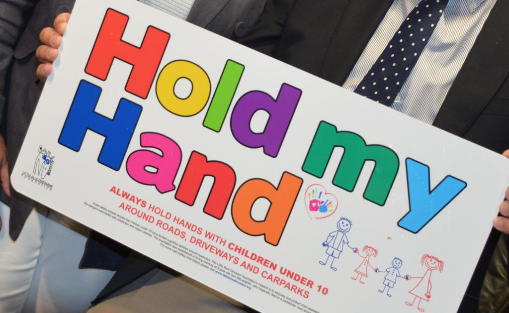 'Hold my hand' road safety sign