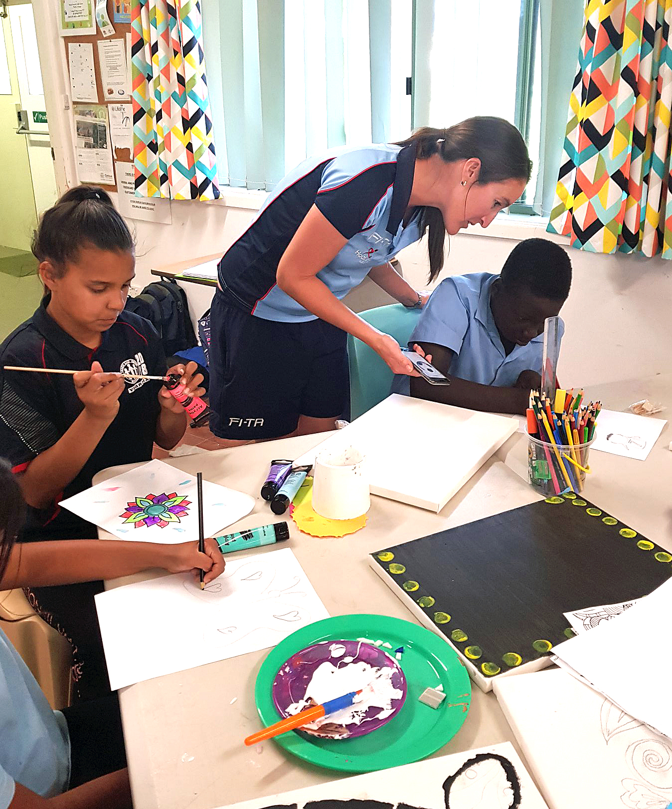 Young people at the Orange Youth Centre getting some tips on art and craft