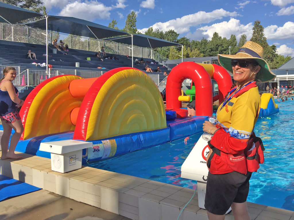 Lifeguard watches inflatable outdoor pool