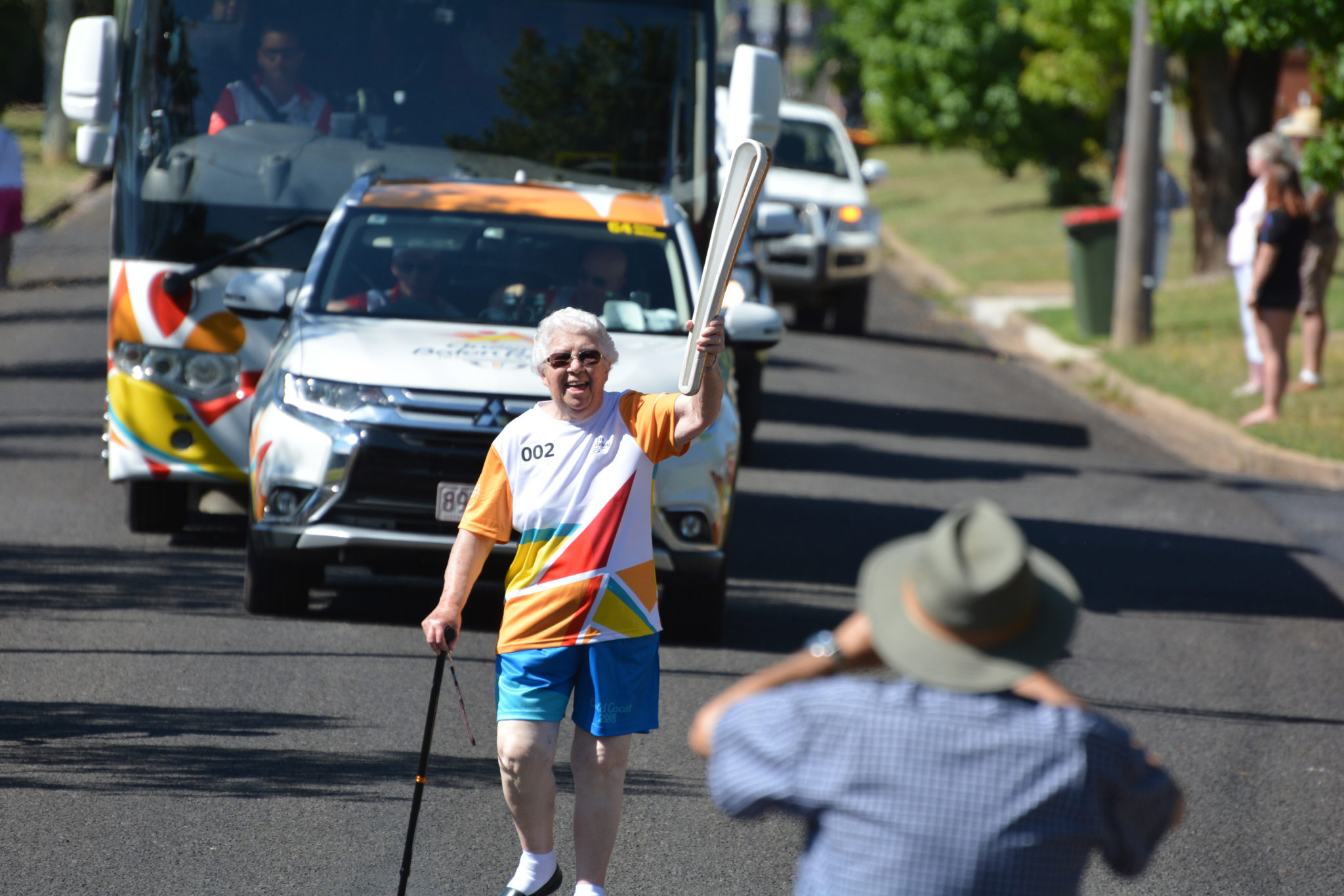 Sister Mary Trainor carrying the Queen's Baton
