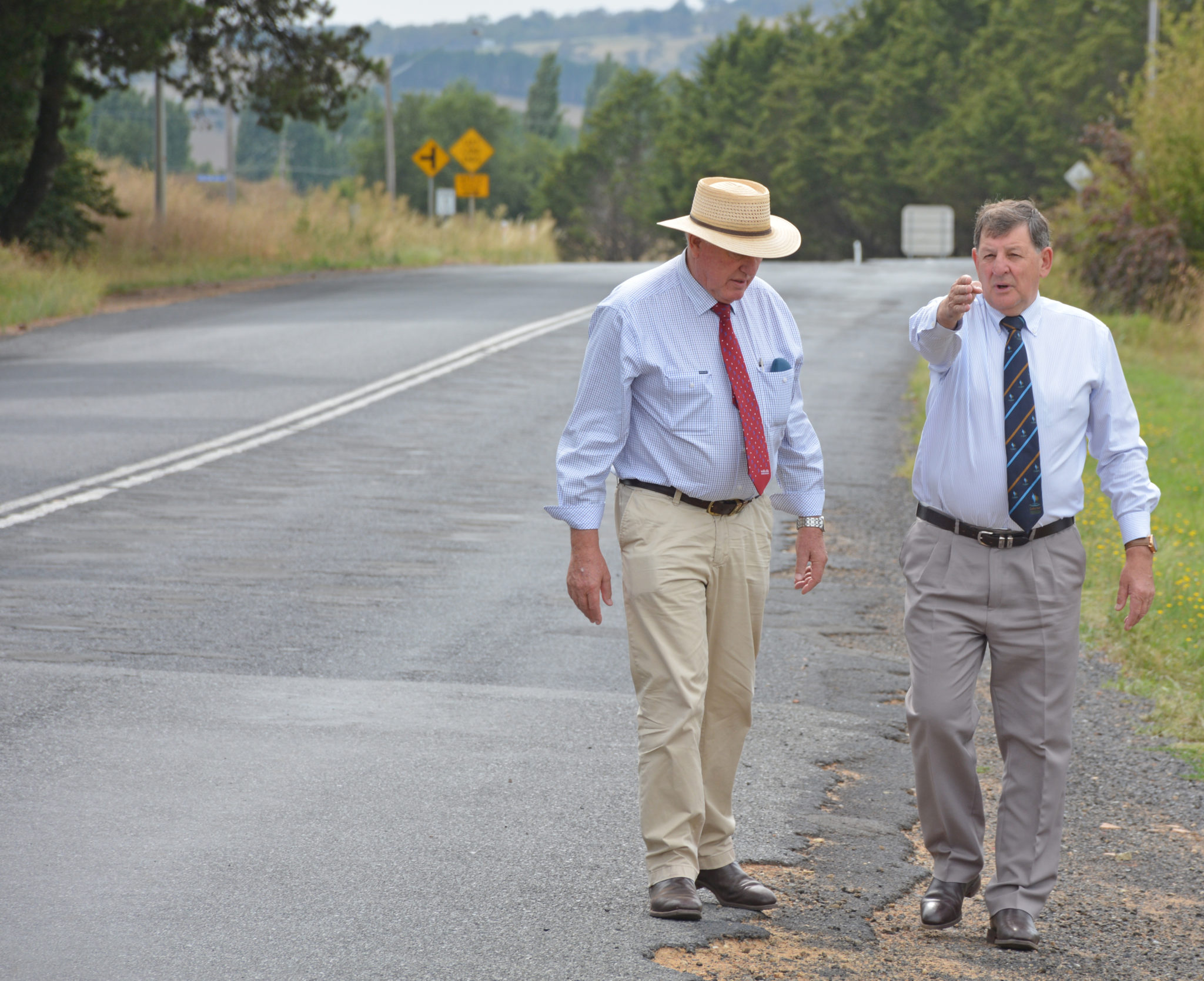 Rick Colless and Reg KIdd inspect site of road upgrade.