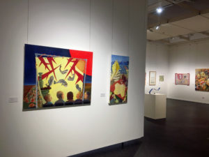 Art works hanging in the gallery