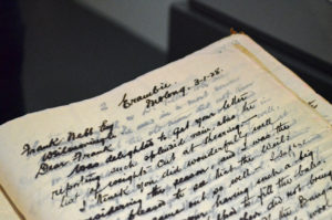 Close up of script from a work ledger