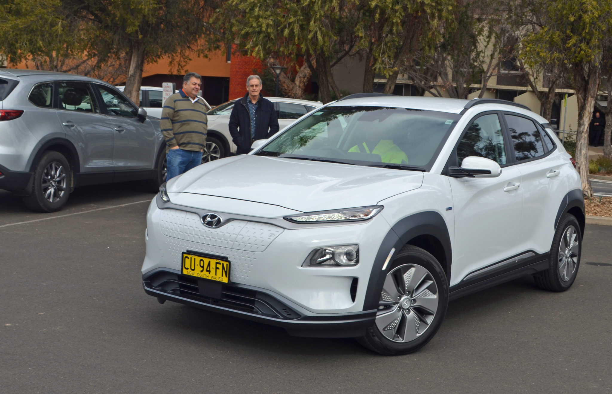 Crs Previtera and Nugent look on as parking officer Lachlan Davis takes off in the Council's first electric vehicle. The Hyundai Kona