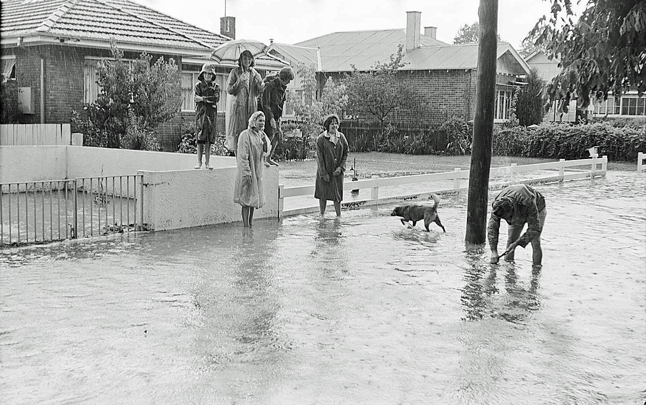 People playing in the flash flooding in Kite Street in 1966