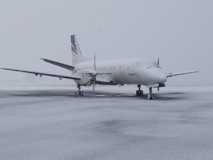 REX plane grounded and covered in snow