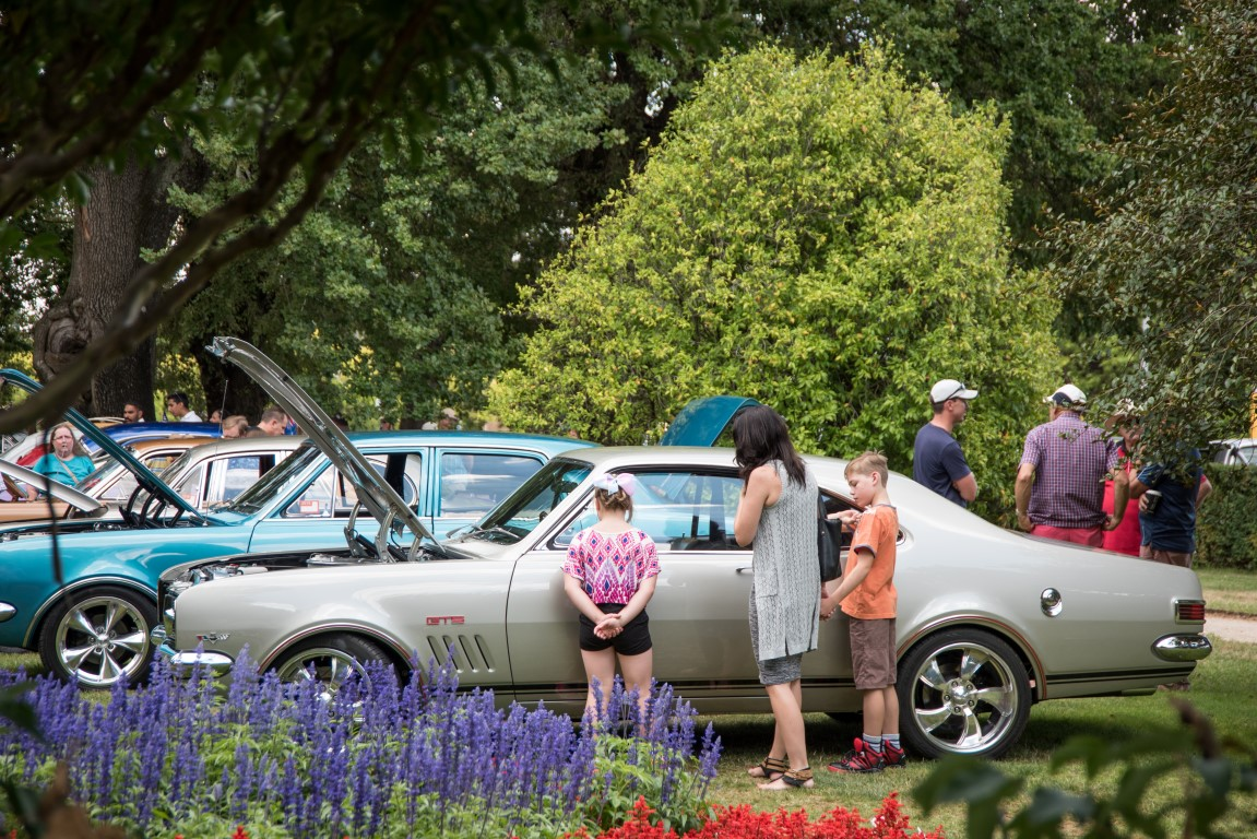 People looking at old cars