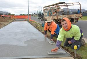 contractors smoothing concrete in Platinum Parade, North Orange