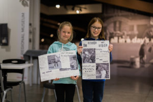 Two girls participating in a previous school holiday activity at Orange Regional Museum.