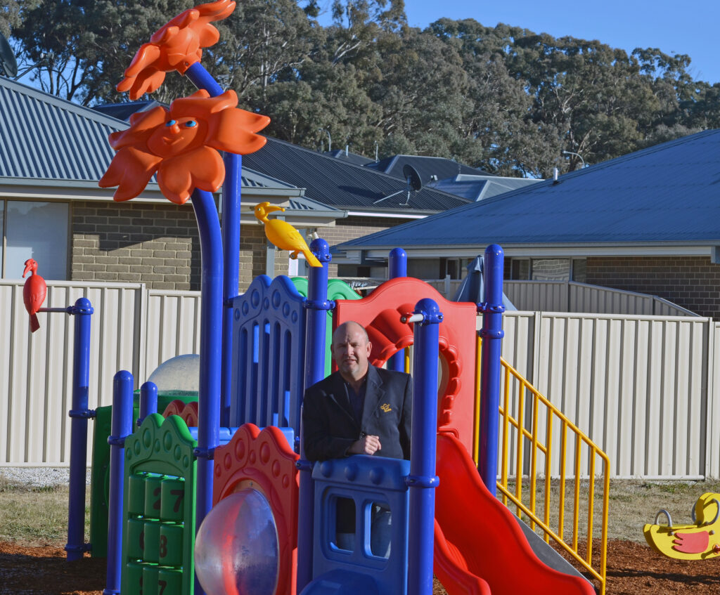 Jason Hamling at a playground in William Maker Drive
