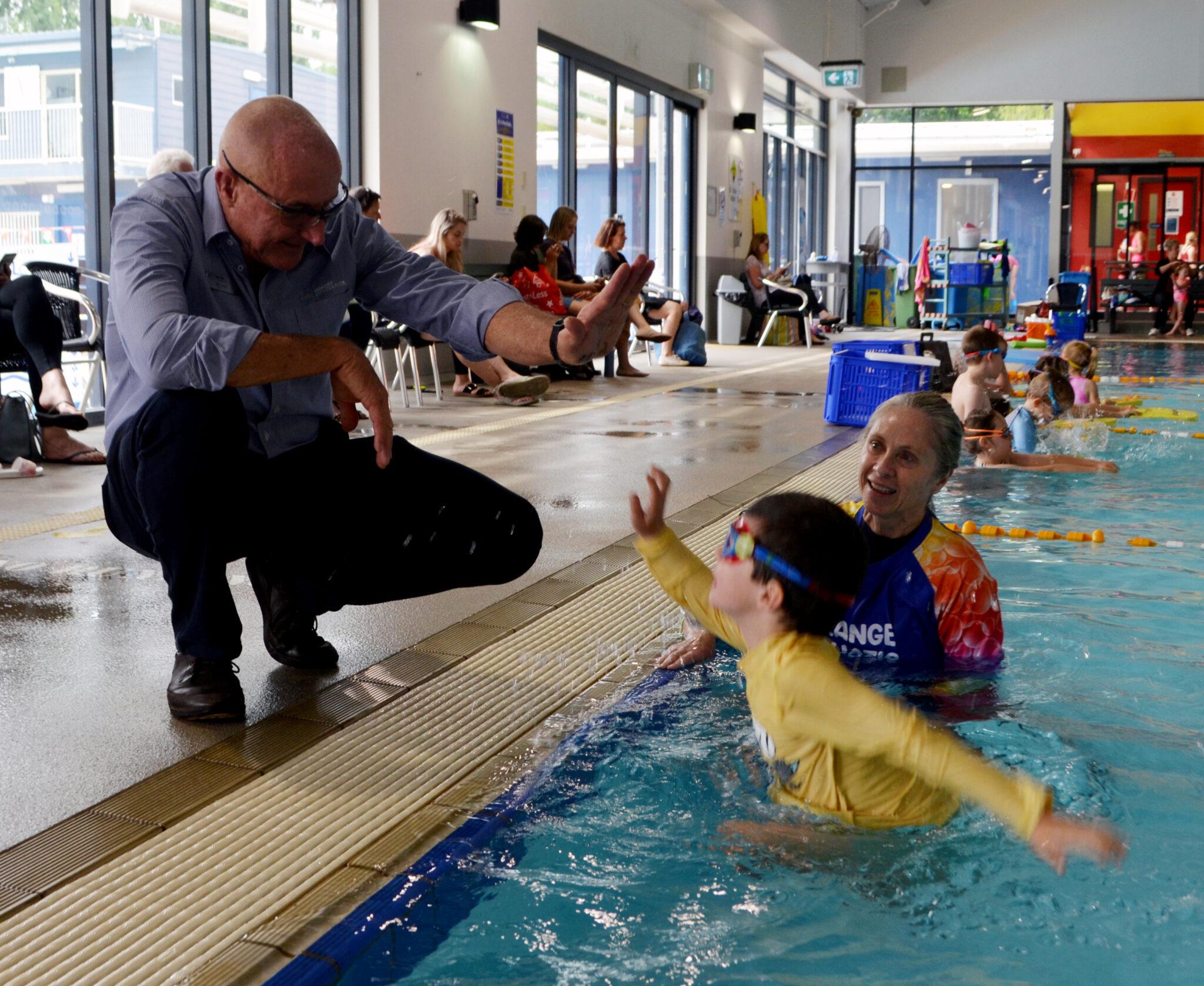 Oscar Paine with Aquatoc Centre Manager Iain Jones and swim physio Theresa Fieldus