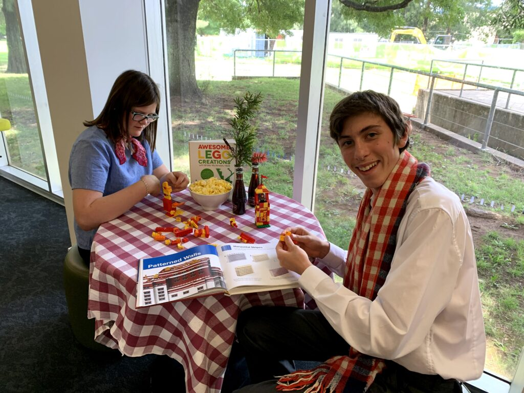 Claire Quinn and Andreas Kuegler prepare for Library Lovers Day at Orange City Library