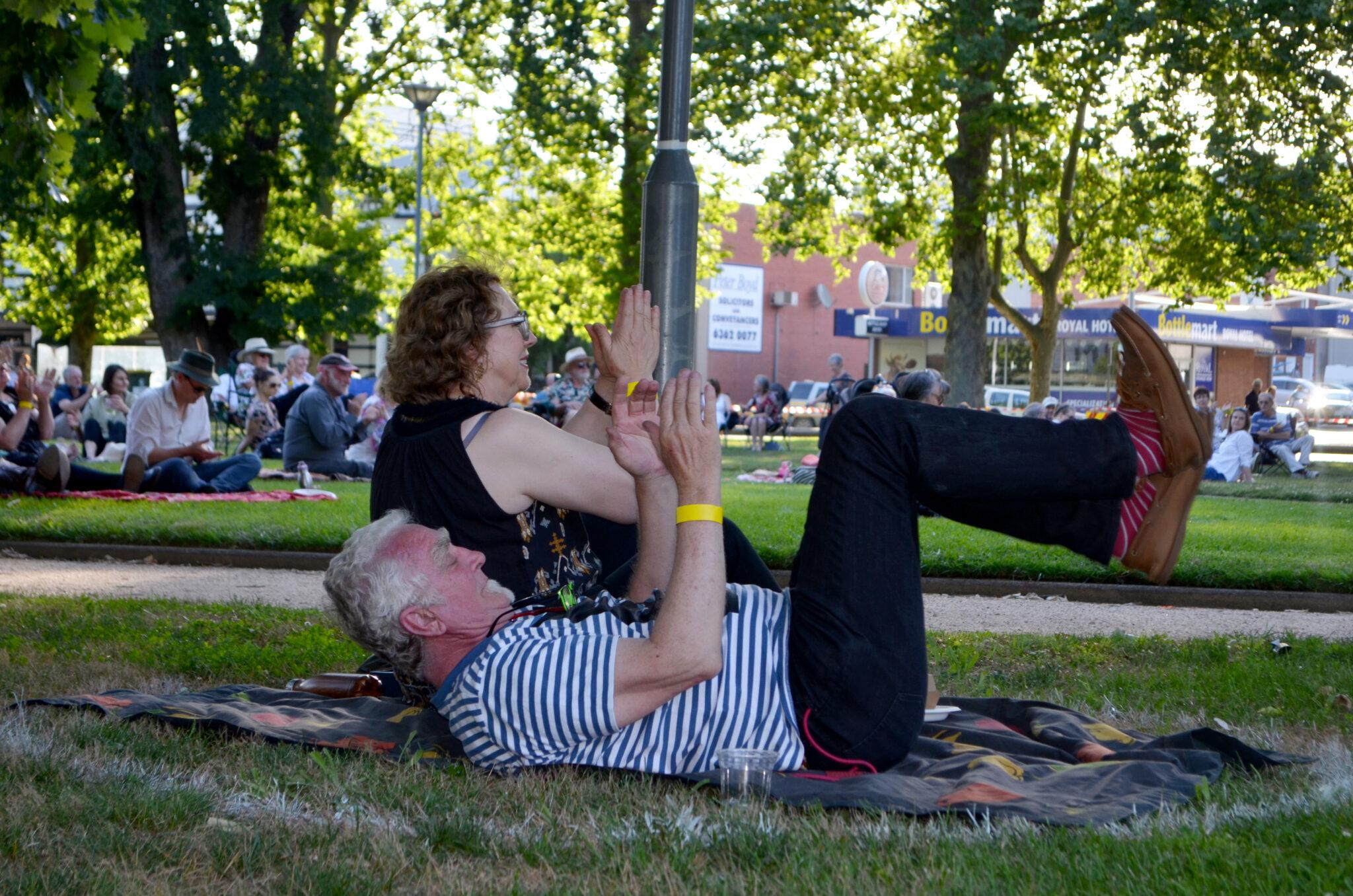 Two people enjoying the music