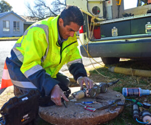 utilities supervisor Eddie Khattar with CCTV camera used for inspecting drains