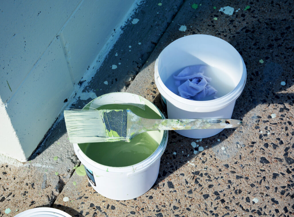 paint buckets and a paint brush